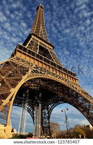 Eiffel Tower in Paris on the winter with the white clouds - stock photo