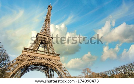 Eiffel Tower in Paris under a thunder-charged sky, France - stock photo