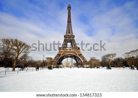 Eiffel Tower in the snow on a sunny winter day - stock photo