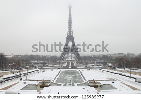 Eiffel Tower in the snowy Paris - stock photo
