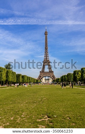 Eiffel Tower (La Tour Eiffel) located on Champ de Mars in Paris, named after engineer Gustave Eiffel. Eiffel Tower is tallest structure in Paris and most visited monument in world.  - stock photo