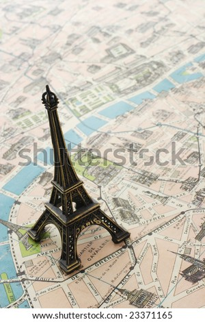 Eiffel tower on a map of Paris - stock photo