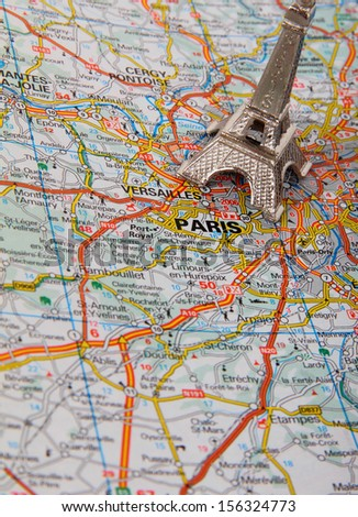 Eiffel Tower on a map of Paris, short focus - stock photo