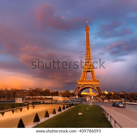 Eiffel tower on a sunset half-lit with last rays of the setting Sun. Panorama made from four horizontal images. This image is toned. - stock photo