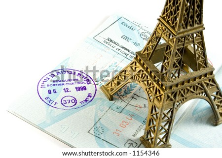 Eiffel tower on stamped passport - stock photo