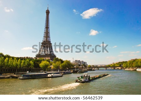 Eiffel Tower on the bank of river Seine - stock photo