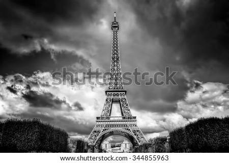 Eiffel Tower seen from Champ de Mars park in Paris, France. French Tour Eiffel in black and white - stock photo