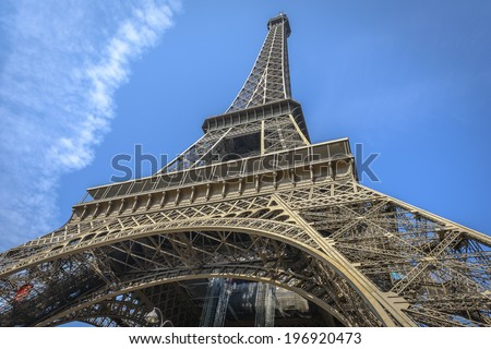 Eiffel Tower shot from a low angle from one of the pillars in Paris, France - stock photo