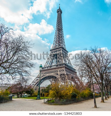 Eiffel tower, view from Champ de Mars in Paris, France - stock photo