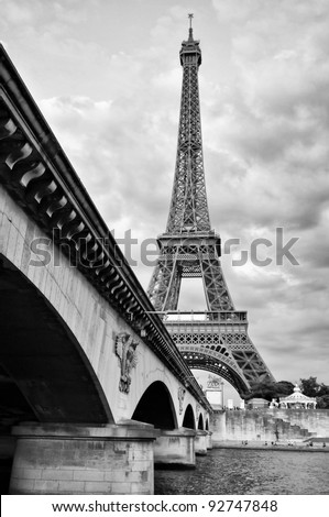 Eiffel tower view from Seine river under the bridge - stock photo