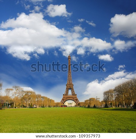 Eiffel Tower  with blue sky and park  in  Paris, France - stock photo