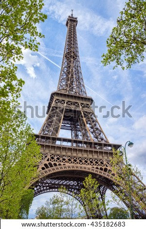 Eiffel tower with blue sky in the background, Paris, France. - stock photo