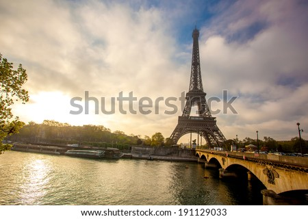 Eiffel Tower with boat on Seine in Paris, France  - stock photo
