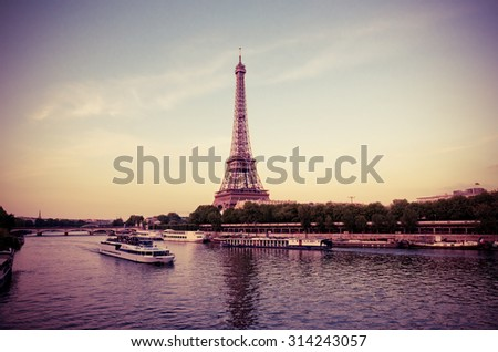 Eiffel Tower with boats in evening Paris, France. Instagram style filtred image - stock photo
