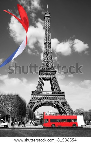 Eiffel Tower with flag and bus in Paris, France - stock photo