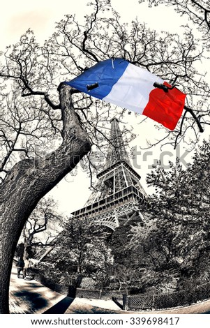 Eiffel Tower with French flag flying on the tree in France - stock photo