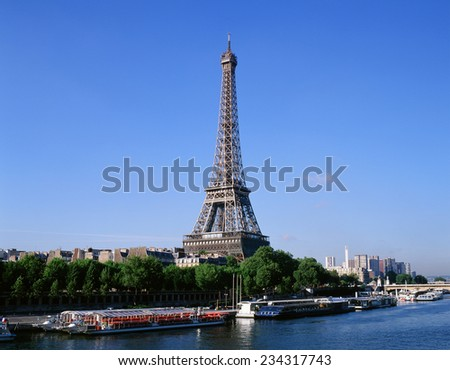 Eiffel Tower with Seine River and sightseeing boats, Paris, France - stock photo