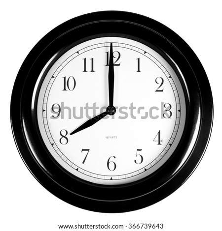 Eight o'clock on the black wall clock, isolated on white background - stock photo