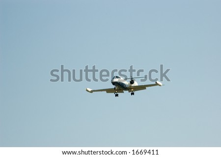Eight seat, dual engine private business jet comes in for a landing. Room for text. - stock photo