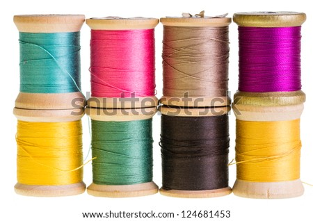 Eight spools of sewing thread isolated on white - stock photo