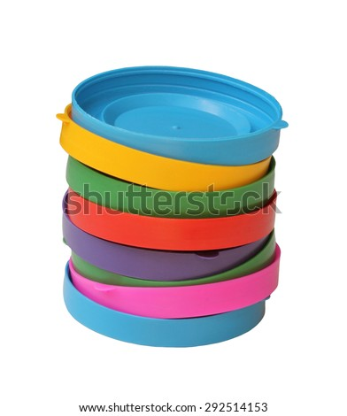 Eight stacked colored lids for glass jars - stock photo