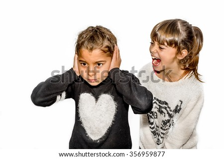 Eight year old girl being angry and shouting at her sister. Isolated on white. - stock photo