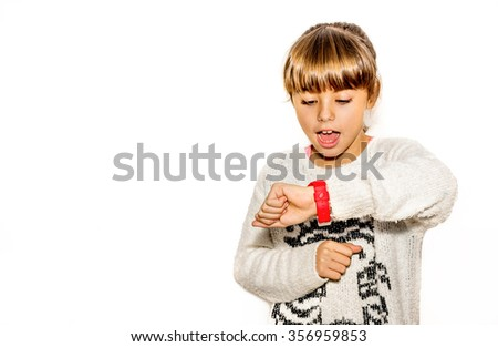 Eight year old girl looking at her watch surprised at what time it is - stock photo