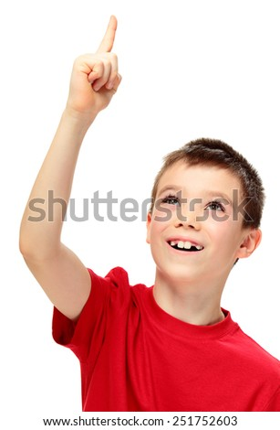 Eight years boy pointing something on white background - stock photo