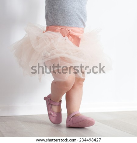 Eighth-month child in princess costume - stock photo