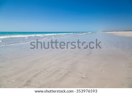 Eighty Mile Beach between Port Hedland and Broome, and is an ideal stopover on this long stretch of road. Australia This beach actually is 220 kilometeres home land of the Nyangumarta people - stock photo