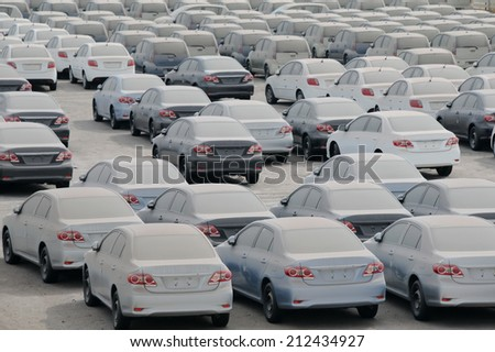 EILAT, ISRAEL - NOVEMBER 13, 2010: Cars in the port of Eilat in Israel covered with dust and desert sand - stock photo