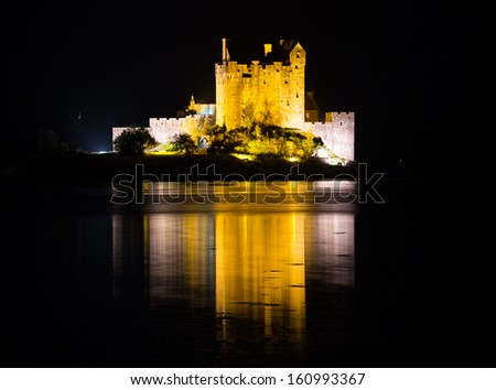 Eilean Donan Castle at night in Scotland, UK - stock photo