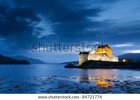 Eilean Donan Castle at twilight, Scotland, UK - stock photo