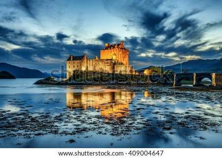 Eilean Donan Castle during blue hour after sunset. - stock photo