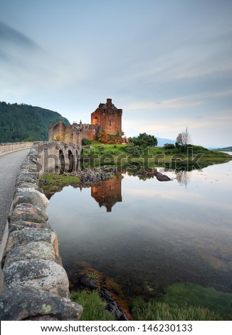 Eilean Donan Castle reflecting on Loch Duich, Dornie, Scotland. - stock photo