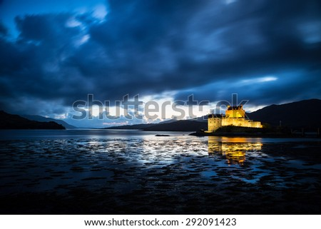Eilean Donan Castle, Scotland, during a windy night. - stock photo