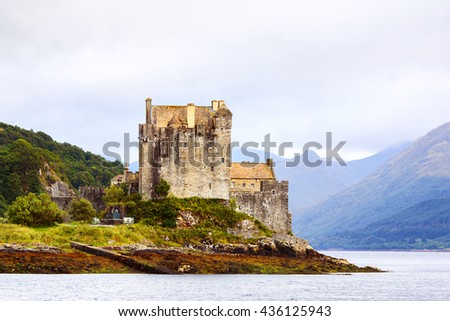 Eilean Donan castle Scotland. Side view of the famous Scottish castle with mountains in the bacground. UK - stock photo