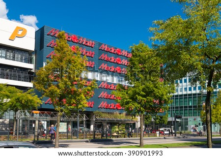 EINDHOVEN, NETHERLANDS - AUGUST 26, 2015: Exterior of the Media Markt electronics store. Media Markt is a German retail chain that specializes in consumer electronics. - stock photo