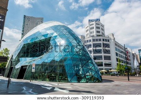 Eindhoven, Netherlands - May 24, 2015: Day view of the old Philips factory building and modern futuristic building in the city centre of Eindhoven. Western Europe - stock photo