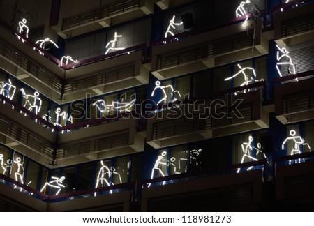 "EINDHOVEN/NETHERLANDS - 14 NOVEMBER-2012: figures on building during lightshow  ""Glow 2012"" in Eindhoven at 14-november-2012 - stock photo"