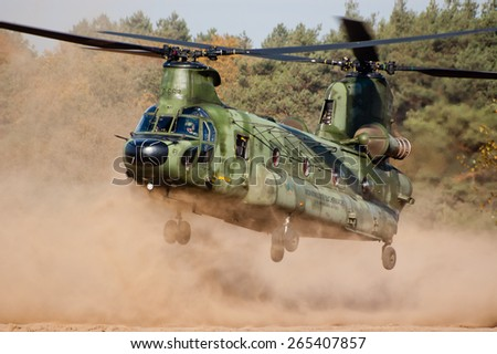EINDHOVEN, THE NETHERLANDS--11 JULY 2014-- Royal Dutch Air Force Chinook helicopter is landing on the ground.  - stock photo