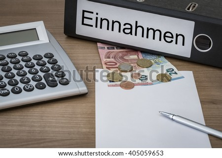 Einnahmen (German Income) written on a binder on a desk with euro money calculator blank sheet and pen - stock photo