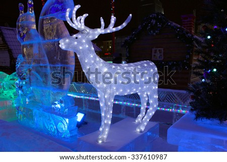 Ekaterinburg, Russia - December 25, 2014: Ice sculpture of a deer. Christmas decoration - stock photo