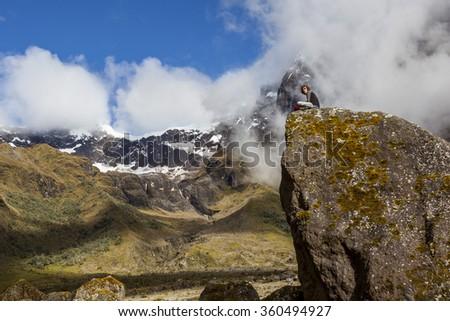 EL ALTAR, ECUADOR - MARCH 08:  Hiker unidentified walking around the crater of El Altar volcano, taking a break on march 08 2015, El Altar, Ecuador - stock photo