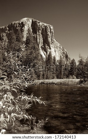 El Capitan towers 3000 feet over the tranquil Merced River. - stock photo
