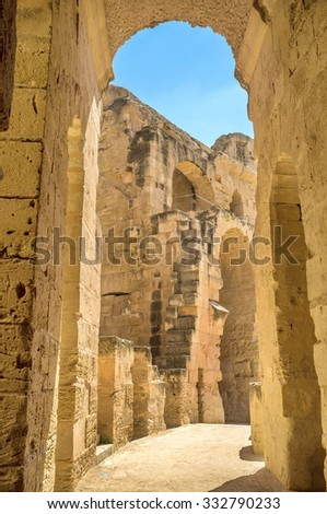 EL JEM, TUNISIA - SEPTEMBER 1, 2015: The Roman amphitheatre were built of the yellow tufa, a type of the limestone, on September 1, in El Jem. - stock photo