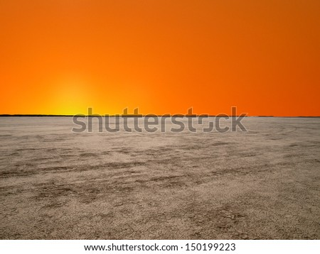 El Mirage dry lake with sunrise sky in California's Mojave Desert. - stock photo
