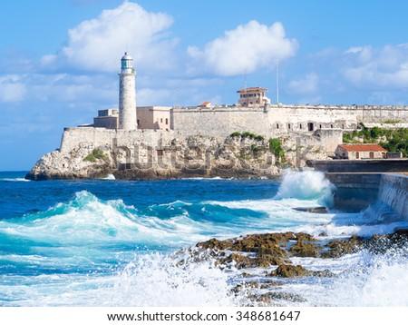 El Morro castle in Havana with sea waves crashing on the Malecon seawall - stock photo