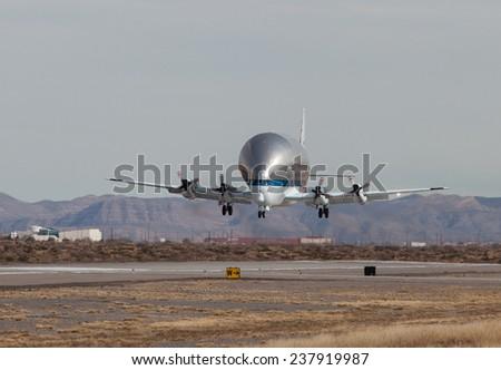 "EL PASO - DECEMBER 15.  NASA lands the ""Guppy"" at the El Paso International Airport on December 15, 2014 at El Paso, Texas.   - stock photo"