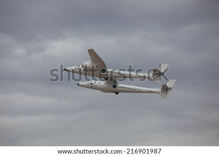 EL PASO SEPTEMBER 11.  Virgin Galactic, White Knight Two, in flight after refueling El Paso International Airport on its way to Spaceport America on September 11, 2014 at El Paso, Texas. - stock photo